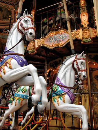 Colorful vintage carousel from France in early evening setting
