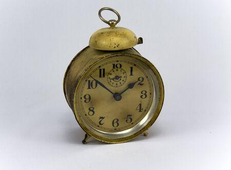 Vintage alarm clock on isolated background