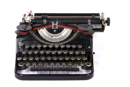 Old typewriter on isolated background photo