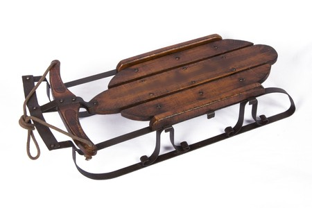 antique sleigh: Old snow sled on isolated background
