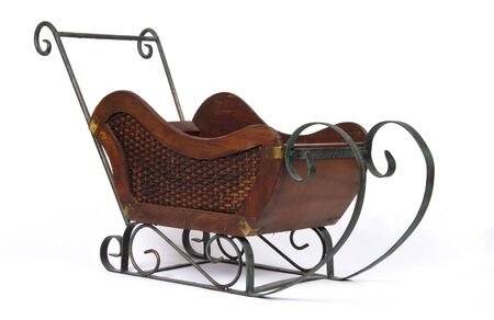 antique sleigh: Old snow sleigh on isolated background