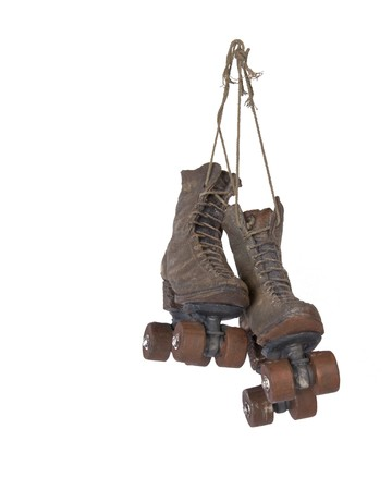 roller: Hanging ornamental vintage roller skates  Stock Photo