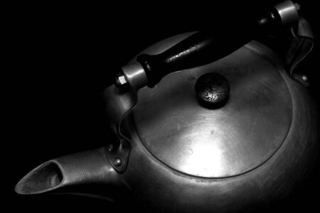 Close up of an old wood stove water kettle photo