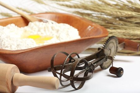 Old time baking preparation and utensils photo