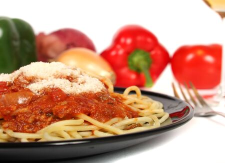 Healthy spaghetti dish with sprinkle of parmesan cheese. photo