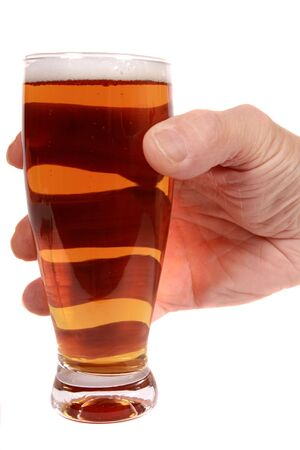 Hand holding a glass of draufgt beer isolated on white Stock Photo - 6062588