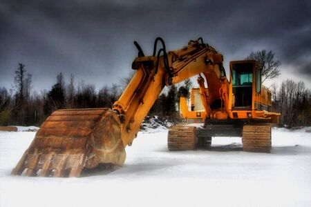 Earth digger at rest in the cold winter