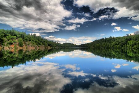 Fresh water Canadian lake and cloudscape