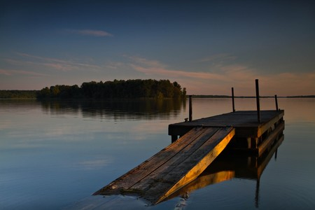 Dock on a Canadian lake at sunset  Stock Photo - 7334345