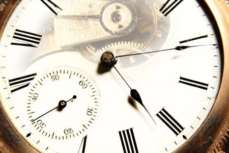 An inside and outside conceptual view of an old pocket watch