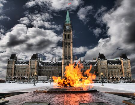 Canadas cetennial flame and parliament building Stock Photo
