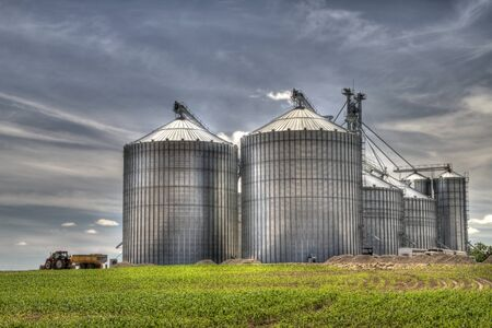 Modern metal silo with blue sky background Stock Photo