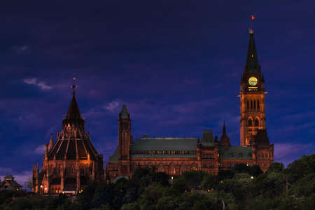 An evening view of Canadas Parliament Building Stock Photo