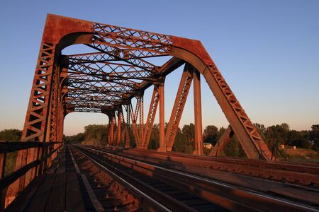 trestle: A view of a steel train trestle at sunset Stock Photo