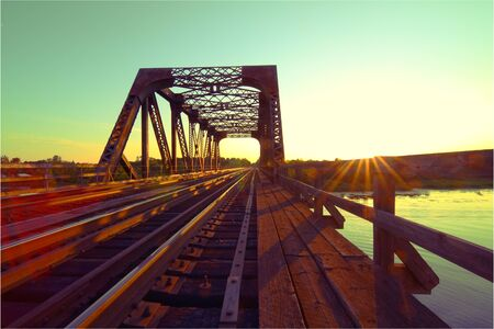 A view of a steel train bridge at sunset Stock Photo - 10163688