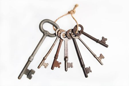 A view of vintage keys on white background Stock Photo