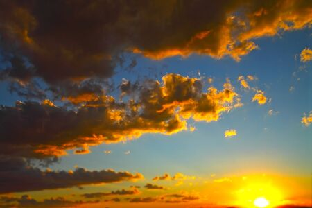 A view of a golden sunset and clouds