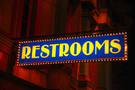 A view of an old vintage restroom sign   photo