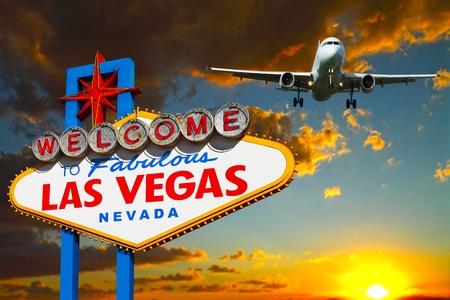 Travel Las Vegas plane landing near Las Vegas welcome sign