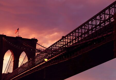 A view of New York Brooklyn bridge at dusk photo