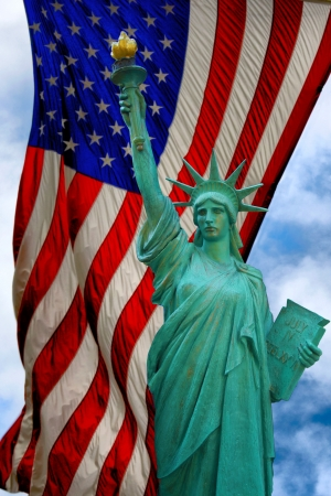liberty statue: A view of the statue of liberty and US flag  Stock Photo