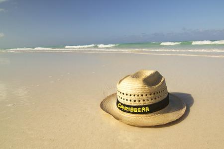 Straw hat on Caribbean beach  Stock Photo