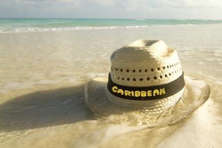 st lucia: Straw hat on Caribbean beach  Stock Photo