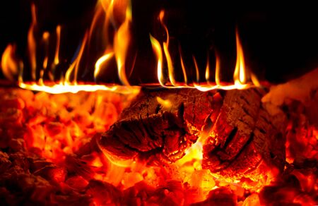 Fire flame wood burning in a wood stove Stock Photo
