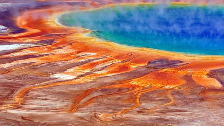 Stunning colors of The Grand Prismatic Spring on a sunny day. Yellowstone National Park