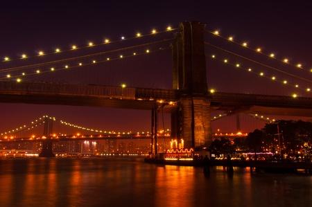 Brooklyn and Manhattan Briedges at night. New York City photo