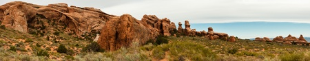 Panorama of Devils Garden with massive Delicate Arch to the left. Arches National Park, Utah photo
