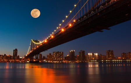 Moon over Manhattan Bridge. New York City Фото со стока