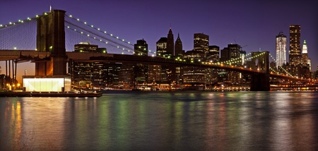 times square: Brooklyn Bridge and Lower Manhattan panorama at dusk. New York City
