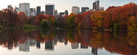 Beautiful Fall dawn panorama in Central Park. Reflections of  New York Skyscrapers in the Lake.  photo