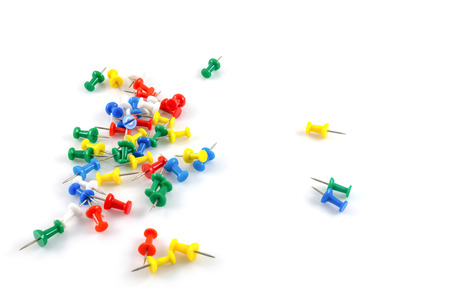 Colorful pushpins on white background photo