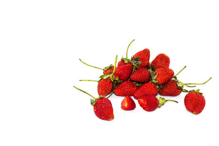 fragaria: Strawberries, ripe red berries and a bite on white background