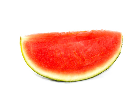 seedless: Red seedless watermelon, cut into pieces on a white background.