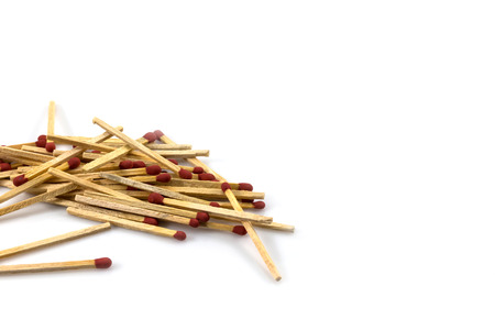 unlit: Pile of matches on a white background Stock Photo