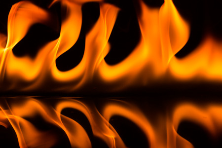 raging: Raging flames on a black background Stock Photo