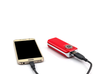 recharging: Red power bank recharging isolated on white background
