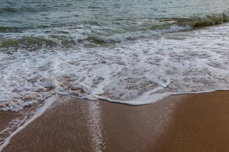 ashore: Close-up detail of the sea waves washing ashore at the beach