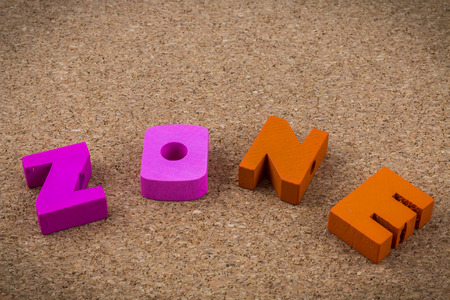 brown cork: Colorful wooden English alphabets set on brown cork wood  background Stock Photo