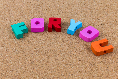 cork wood: Colorful wooden English alphabets for you on brown cork wood  background