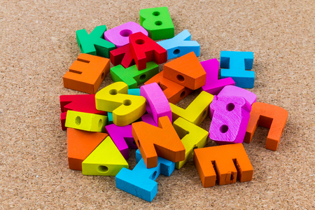 cork wood: English alphabet wood on brown cork wood  background