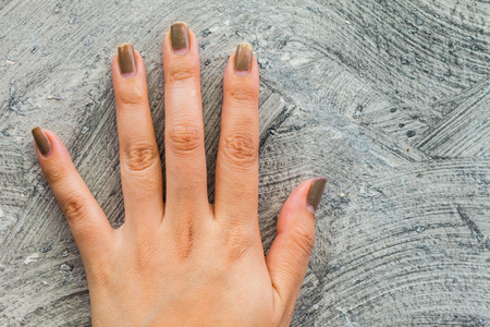 cut wrist: Five fingers on the wall using a background. Stock Photo