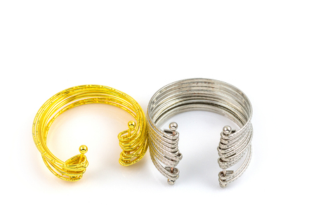 silver jewelry: jewelry bracelets Silver and gold White background Stock Photo