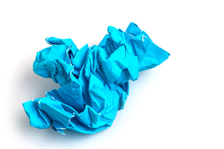 scrunched: Crumpled blue paper a white background