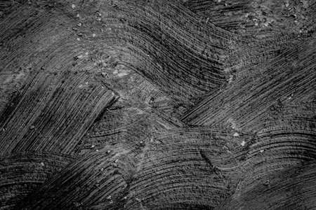 black textured background: abstract black textured rough plaster walls background
