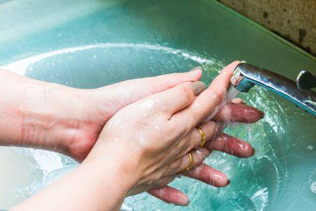 handwashing: Woman handwashing sinks