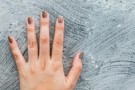five fingers: Five fingers on the wall using a background. Stock Photo